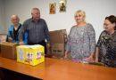 Удружење пензионера - Комисија са председником Недељком Ракићем након преузимања пакета